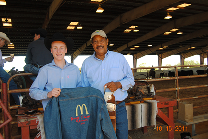 Senior Youth Tyler Johnson presenting Sam Munroe a jacket from the youth.  Sam sponsors the ACHA Youth Shootout every year.  Thank You Sam and McDonald's  :: ACHA - 2011